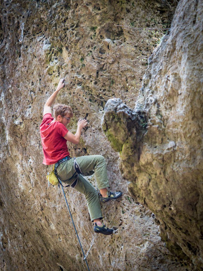 "Climber in ""Solid Rock"" (6c+) - Grüne Hölle, Frankenjura"